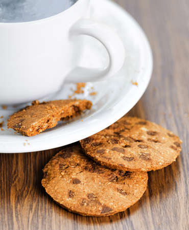 Coffee and oatmeal cookies on wooden table. photo