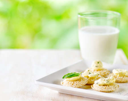 Several canapes and glass of milk. photo