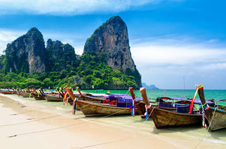 Traditional thai boats at the beach of Krabi province. photo
