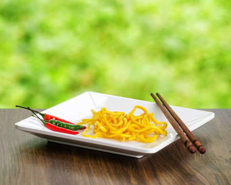 chinese culture: Egg noodles on nature background.