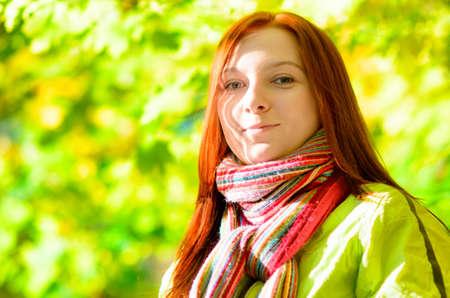 teen girl smile face: Young woman in spring garden.