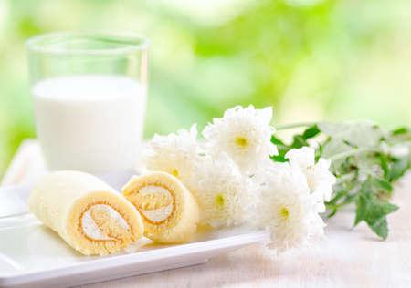 Glass of milk and fresh cake. photo