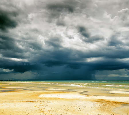 Stormy sky and beach at low tide  photo