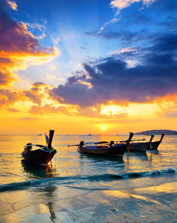 Traditional thai boats at sunset beach  Ao Nang, Krabi province