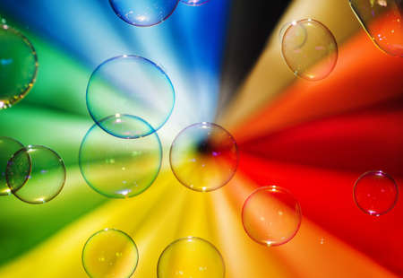 Soap bubbles and multi-coloured background. photo
