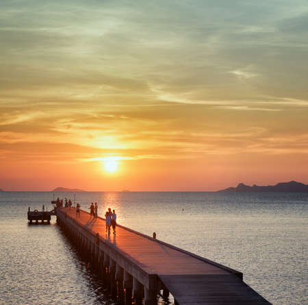 beach sunrise: Boat pier at sunset. Beautiful landscape.
