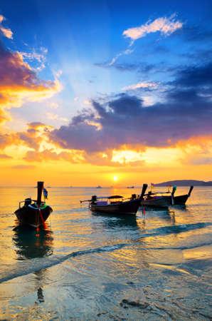 nang: Traditional thai boats at sunset beach. Ao Nang, Krabi province.