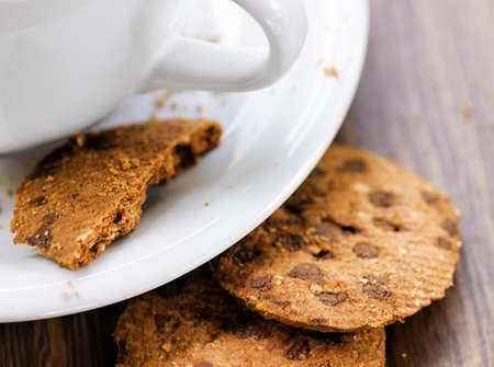 Coffee and oatmeal cookies on wooden table  photo