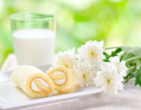 Glass of milk and fresh cake  photo