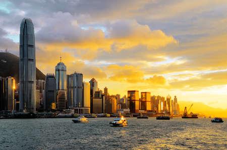 ferry: Skyline of Hong Kong at sunset.