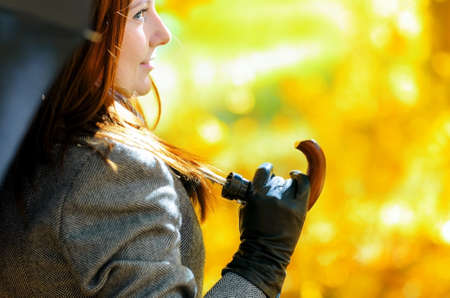 Young woman in autumn park. Outdoor portrait. photo