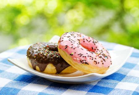 Fresh donuts on nature background. photo