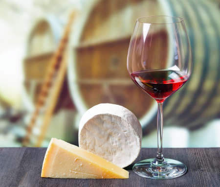 ferment: Glass of wine and cheese in winery