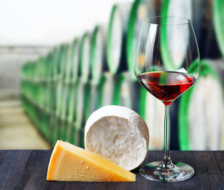 Glass of wine and cheese in winery  photo