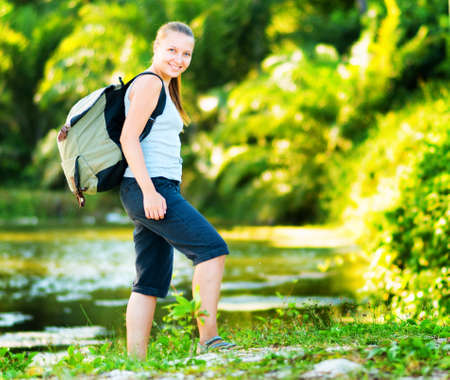 Young woman hiking with backpack. photo