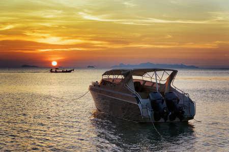 Motorboat at sunset. Beautiful landscape. photo