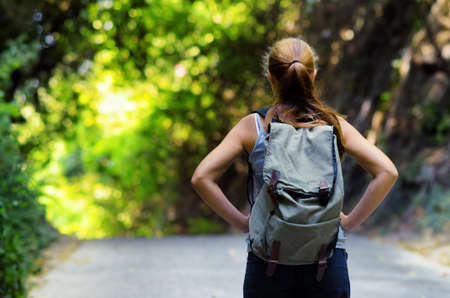 Young woman hiking with backpack. Stock Photo