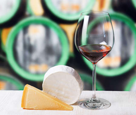 Glass of wine and cheese in winery. photo