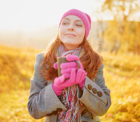 happy faces: Young woman enjoying the fall season. Autumn outdoor portrait. Stock Photo