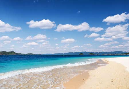 White sand beach and blue sky. Coron, Busuanga island, Palawan province, Philippines. photo