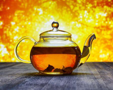 yellow tea pot: Teapot of fresh tea on sky