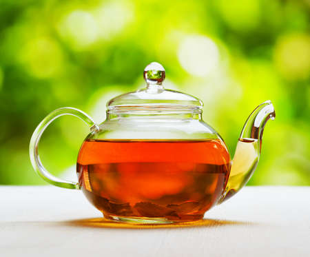 chinese herbs: Teapot of fresh tea on natural background.