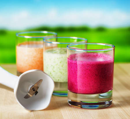 Vegetable smoothie on wooden table on the rural  photo