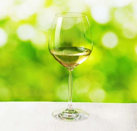 white wine glass: Glass of wine on nature  Stock Photo