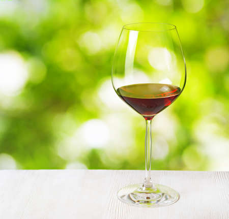 Glass of wine on nature  photo