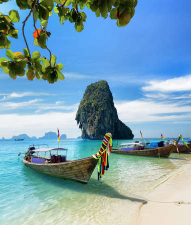 Thai boats on Phra Nang beach, Thailand. 스톡 콘텐츠