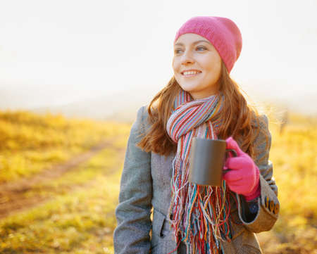 Young woman enjoying the fall season. Autumn outdoor portrait. photo