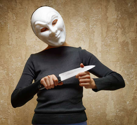 Woman in white mask holding the knife  photo