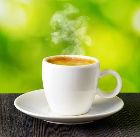 Cup of coffee on nature background. photo