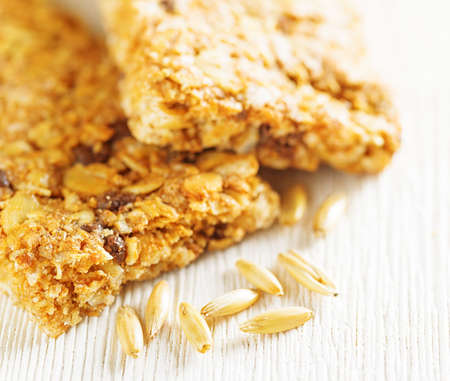 roughage: Oat granola bars on wooden table.