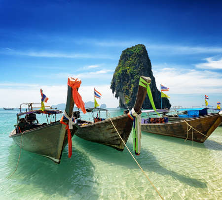Thai boats on Phra Nang beach, Thailand  photo