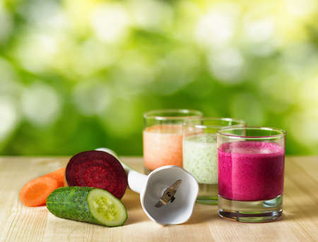 Vegetable smoothie on wooden table on the rural background. photo