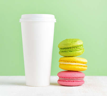 Macaron and tumbler of coffee. photo