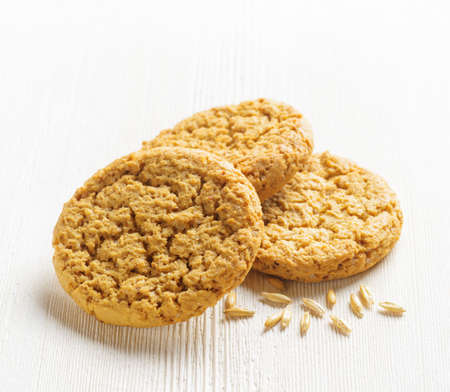 Oatmeal cookies on wooden table. photo