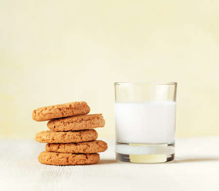 Oatmeal cookies and cup of coffee on wooden table. photo