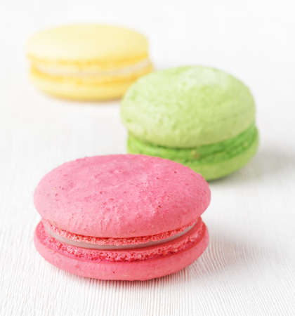 Macaron on white wooden table. photo