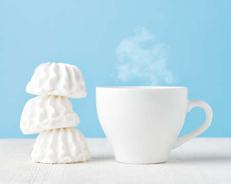 Marshmallow and cup of coffee. photo