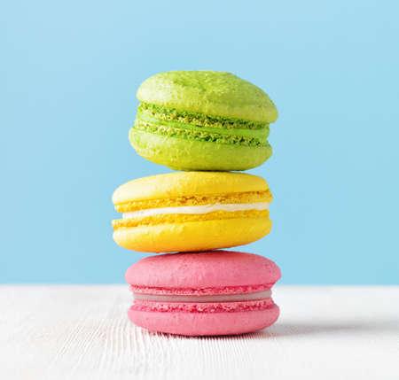 Macaron on white wooden table. photo