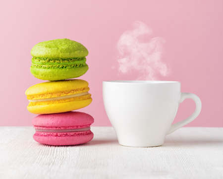 Macaron and cup of coffee. Stock Photo