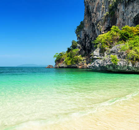 Clear water and blue sky. Phra Nang beach, Thailand. photo