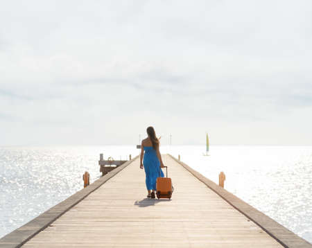 Young woman walking on wooden pier   photo