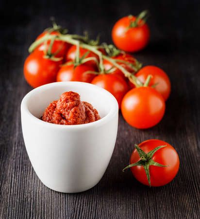tomatos: Ripe tomatoes and tomato paste. Ketchup making.