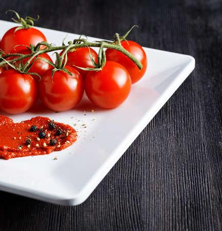 tomato paste: Ripe tomatoes and tomato paste. Ketchup making.