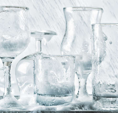 Glassware washing under water jets. photo
