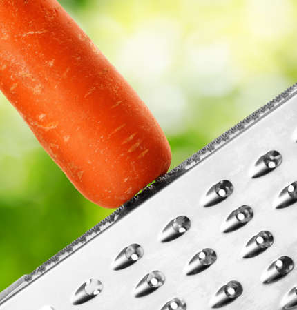 Ripe carrot rubbing on a grater. photo