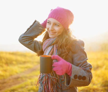 Young woman enjoying the fall season. Autumn outdoor portrait. photo